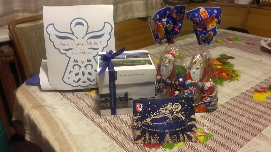 Kalėdų senelio ir merės dovanos
