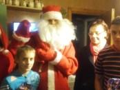 Kalėdų senelis su savo palyda